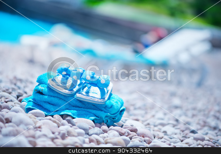 summer background stock photo, summer background, blue towel on sea beach by tycoon