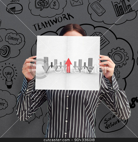 Composite image of businesswoman showing a white card in front o stock photo, Businesswoman showing a white card in front of her face against grey by Wavebreak Media