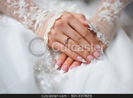 hands of a bride with a ring and a wedding manicure stock photo, hands of a bride with a ring and a wedding manicure. by timonko