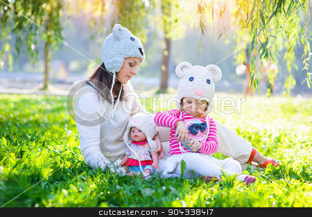 Mom and daughter playing in the park stock photo, Mom and daughter playing in the park. by timonko