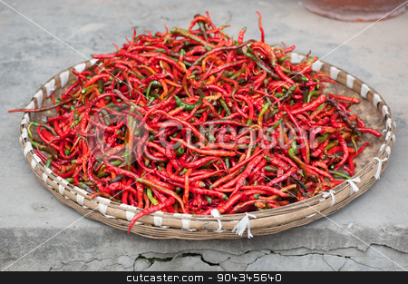 Red pepper drying outdoors stock photo, Red pepper drying outdoors in a basket - Chongzhou, Sichuan Province, China by LP2Studio