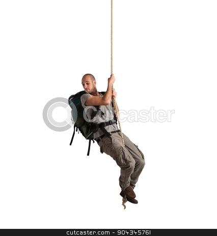 Explorer hanging from a rope stock photo, Explorer with vertigo hanging from a rope by Federico Caputo