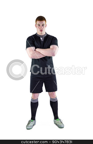 Rugby player with arms crossed stock photo, Portrait of a serious rugby player with arms crossed by Wavebreak Media