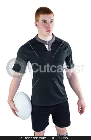 Rugby player holding a rugby ball stock photo, Rugby player holding a rugby ball on a white background by Wavebreak Media