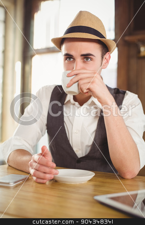 Hipster having cup of coffee stock photo, Hipster having cup of coffee at coffee shop  by Wavebreak Media