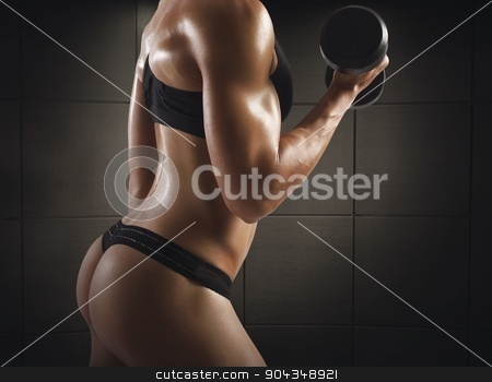 Sexy gym female stock photo, Gym woman train with dumbbell in thong by Federico Caputo