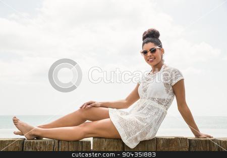 Pretty woman in sun dress stock photo, Pretty woman in sun dress at the beach by Wavebreak Media