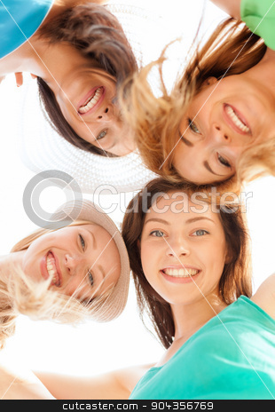 faces of girls looking down and smiling stock photo, summer holidays and vacation concept - faces of girls looking down and smiling by Syda Productions