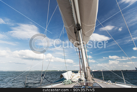 close up of sailboat mast or yacht sailing on sea stock photo, vacation, travel, cruise and leisure concept - close up of sailboat mast or yacht sailing on sea by Syda Productions