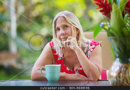 Lady with Doubtful Expression stock photo, Attractive lady with doubtful expression with cup by Scott Griessel