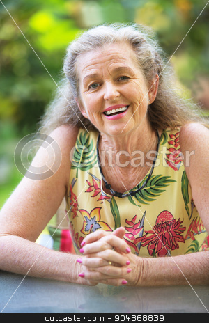 Smiling Woman With Folded Hands stock photo, Smiling woman with gray hair and folded hands by Scott Griessel