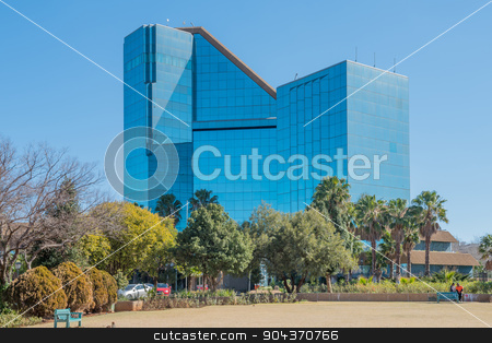 Bram Fischer Building in Bloemfontein stock photo, BLOEMFONTEIN, SOUTH AFRICA - JULY 19, 2015: The Bram Fischer Building (local municipality building), also called the glass palace, was inaugurated in 1992 by Grobler du Preez