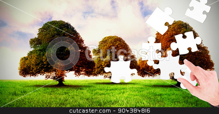 Composite image of businessman measuring something with these fi stock photo, Businessman measuring something with these fingers against trees in green field by Wavebreak Media