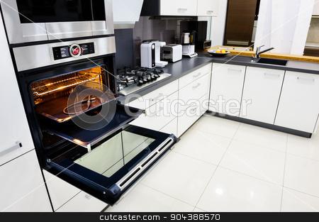 Modern hi-tek kitchen, oven with open door stock photo, Modern luxury hi-tek black and white kitchen, clean interior design, focu at oven with open door by Serghei Starus