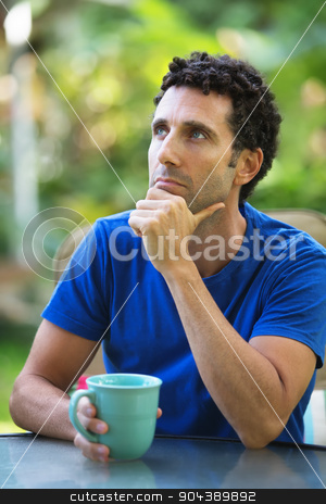 Pensive Man Looking Up stock photo, Pensive Caucasian adult sitting outdoors in Maui by Scott Griessel