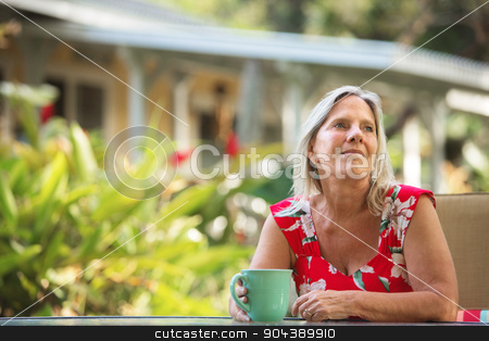 Cheerful Woman Having Coffee stock photo, One cheerful mature woman having coffee outdoors by Scott Griessel