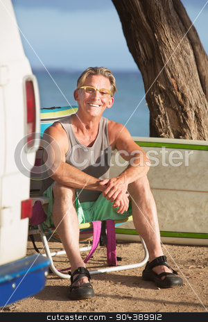 Smiling Adult Sitting with Surfboard stock photo, Smiling adult Caucasian surfer sitting outdoors by Scott Griessel