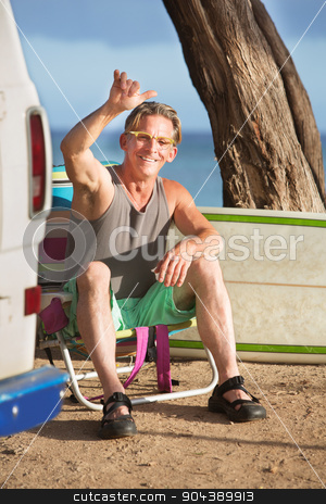 Athletic Male Surfer Relaxing stock photo, Athletic single male surfer gesturing at ocean beach by Scott Griessel