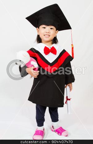 Asian Child Graduation stock photo, Chinese little girl graduation in white backround studio shot. by Tan Kian Khoon