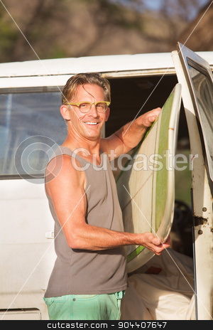 Person with Surfboard in Van stock photo, Smiling person with eyeglasses taking a surfboard from his van by Scott Griessel
