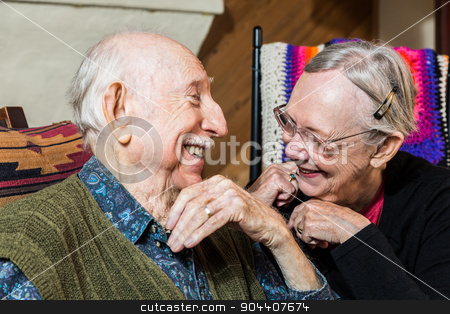 Happy Elderly Couple stock photo, Happy Caucasian elderly couple sitting indoors smiling by Scott Griessel