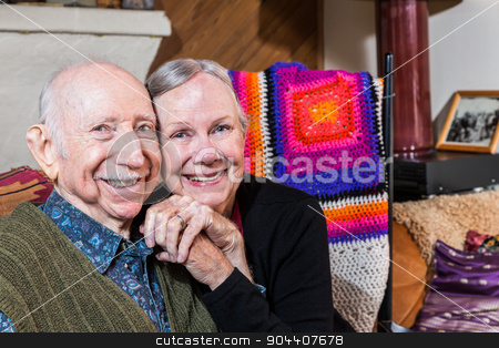 Happy Senior Couple stock photo, Happy senior couple sitting and holding hands by Scott Griessel