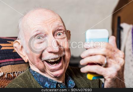 Older Gentleman Taking Selfie stock photo, Older gentleman taking a selfie with smartphone by Scott Griessel