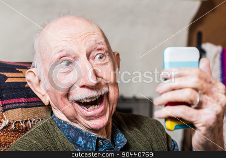Elderly Gentleman with Smartphone stock photo, Elderly gentleman taking a selfie with smartphone by Scott Griessel