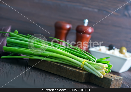 fresh onion stock photo, fresh onion on wooden board and on a table by tycoon