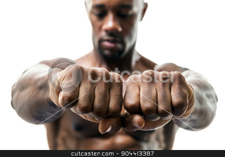 Man Showing Fists and Knuckles stock photo, Muscular man of African descent isolated over a white background showing a closeup of his fists and knuckles.  Shallow depth of field. by Todd Arena