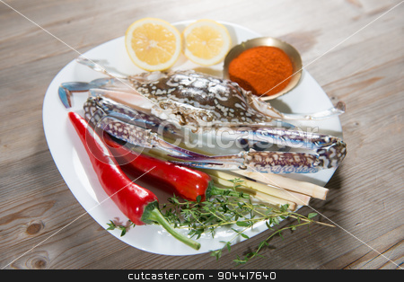 Raw blue crab and ingredients on white plate stock photo, Raw blue crab and ingredients ready to cook, on white plate.  by szefei