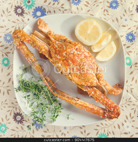 Hot and spicy sauce crab stock photo, Top view cooked delicious hot and spicy sauce blue crab on white plate with vintage tone. by szefei