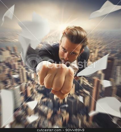 Businessman like a superhero stock photo, Businessman flying over the city like superhero by Federico Caputo