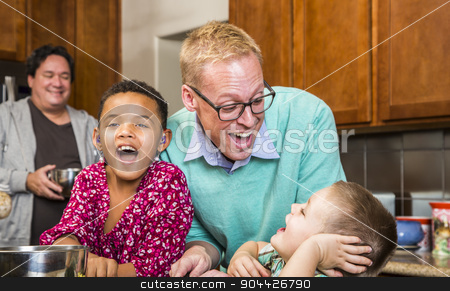 Family with Two Gay Men Laughing stock photo, Same sex couple with two adorable children laughing in kitchen by Scott Griessel