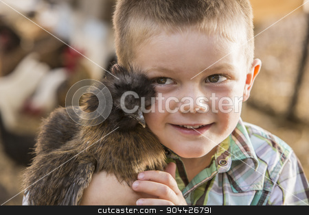 Handsome Young Boy with Show Chicken stock photo, Smiling young boy holding fancy show chicken by Scott Griessel