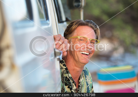 Laughing Man Sitting In Van stock photo, Single laughing adult man sitting outside of van by Scott Griessel