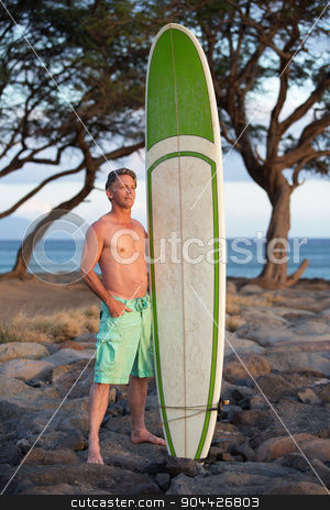 Surfer Posing with Surfboard stock photo, Single adult surfer posing with surfboard outdoors by Scott Griessel