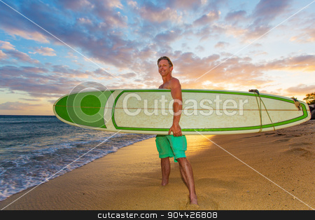 Upbeat Surfer at Sunset stock photo, Athletic upbeat adult holding his surfboard on beach at sunset by Scott Griessel