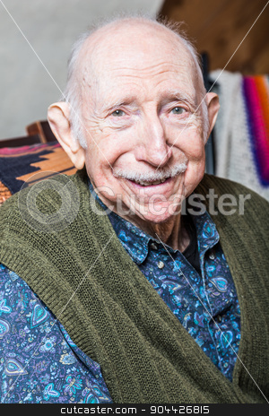 Older Gentleman Smiling at Camera stock photo, Older gentleman in green vest smiling into the camera by Scott Griessel