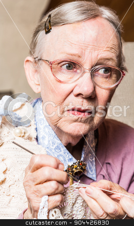 Old Women Crocheting stock photo, Old woman crocheting with worried expression by Scott Griessel