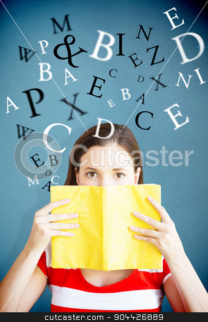 Composite image of student covering face with book in library stock photo, Student covering face with book in library against blue background by Wavebreak Media