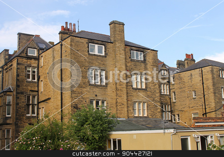 Urban housing stock photo, Rear view of flats and apartments converted from old buildings. by Martin Crowdy
