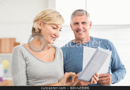 Smiling business colleagues working together stock photo, Smiling business colleagues working together at office by Wavebreak Media