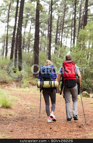 Young happy hiker couple hiking stock photo, Young happy hiker couple hiking in the nature by Wavebreak Media