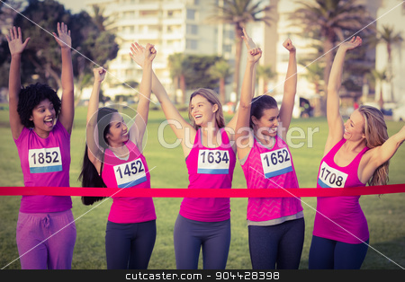 Cheering women supporting breast cancer marathon stock photo, Cheering women supporting breast cancer marathon in parkland by Wavebreak Media