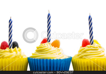 Birthday cupcakes on a table stock photo, Birthday cupcakes on a table shot in studio by Wavebreak Media