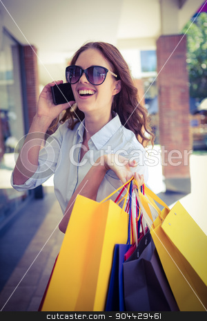 Pretty woman shopping at the mall stock photo, Pretty woman shopping at the mall on a sunny day by Wavebreak Media