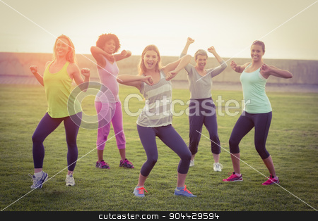 Happy sporty women dancing during fitness class stock photo, Portrait of happy sporty women dancing during fitness class in parkland by Wavebreak Media