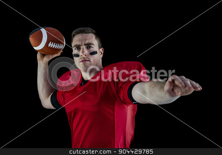 American football player about to throw the ball stock photo, Determined american football player about to throw the ball by Wavebreak Media