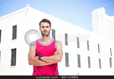 Concentrated athlete with arms folded stock photo, Portrait of a focus athlete with arms folded on a sunny day by Wavebreak Media